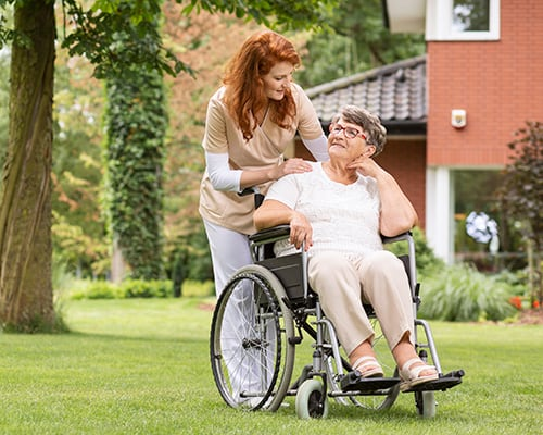 woman in wheelchair outdoors
